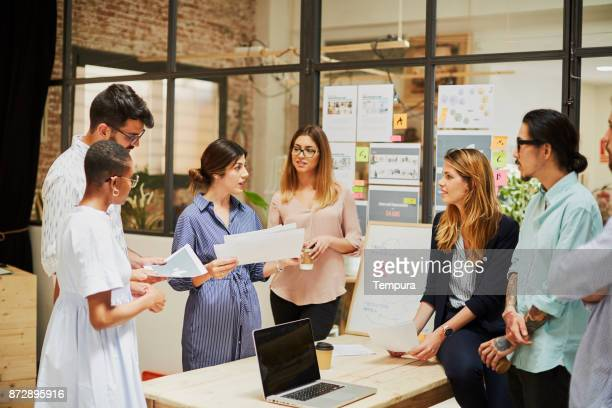 team work, meeting in a table. new strategies. - millenial stock photos and pictures