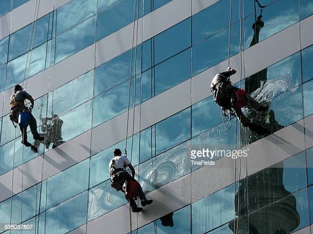 team work, window washers. - window cleaning stock photos and pictures