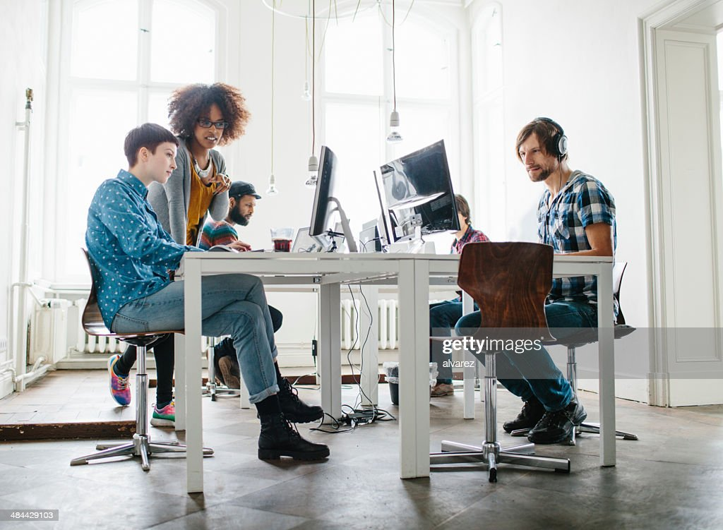 Team working at a start up : Stock Photo