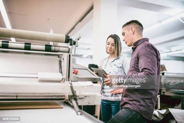 Team Working in Textile Factory on 3D Clothing Printing