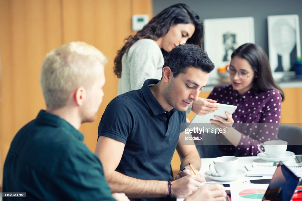 Team working over new project : Stock Photo