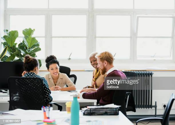 team working together - creative director stock pictures, royalty-free photos & images