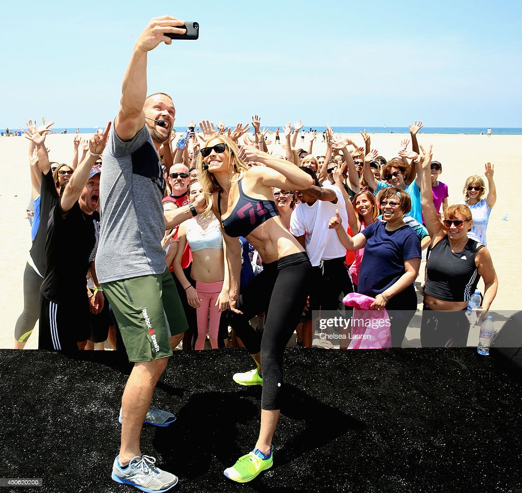 Team Workout personal trainers Chris (front L) and Heidi Powell (front R) and guests attend OK! Body & Soul 2014 at The Casa Del Mar Hotel on June 14, 2014 in Santa Monica, California.