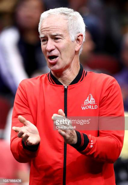 Team World Captain John McEnroe of the United States celebrates a point by Team World John Isner of the United States against Team Europe Alexander...