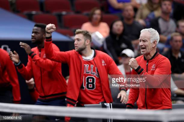 Team World Captain John McEnroe of the United States celebrates a point by Team World Kevin Anderson of South Africa against Team Europe Alexander...