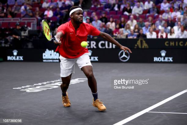 Team World Frances Tiafoe of the United States returns a shot against Team Europe Grigor Dimitrov of of Bulgaria during their Men's Singles match on...