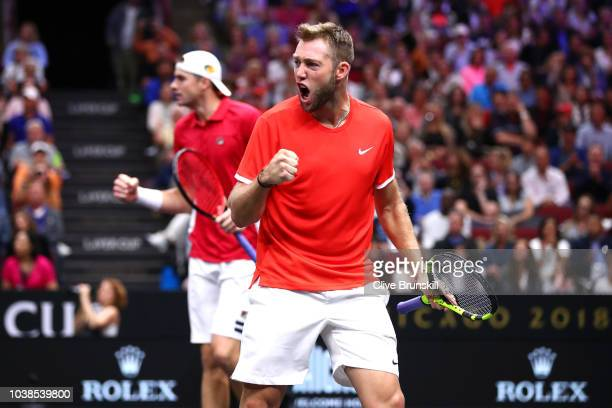 Team World Jack Sock of the United States and Team World John Isner of the United States celebrate a point against Team Europe Alexander Zverev of...