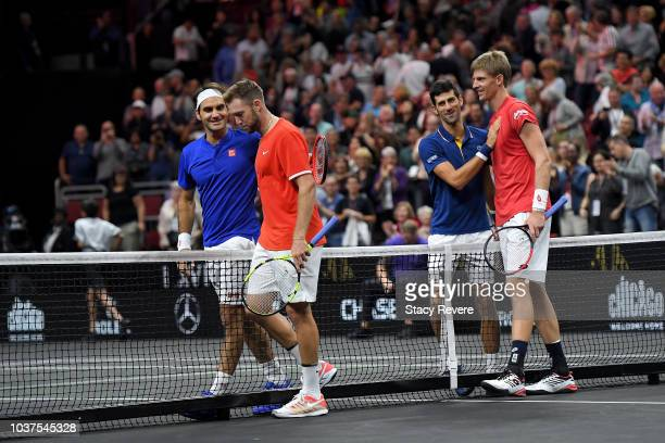 Team World Jack Sock of the United States and Team World Kevin Anderson of South Africa shake hands with Team Europe Novak Djokovic of Serbia Team...