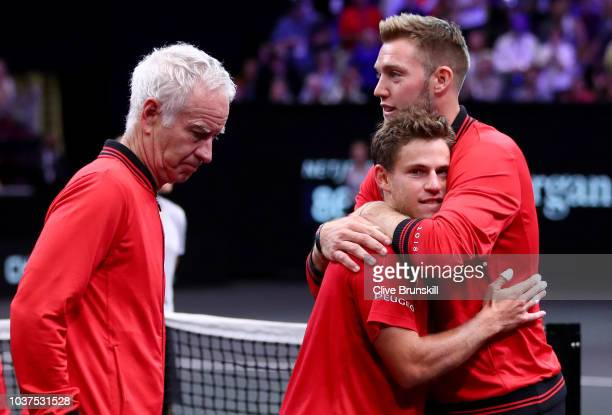 Team World Jack Sock of the United States reacts with Team World Jack Sock of the United States after losing to Team Europe David Goffin of Belgium...