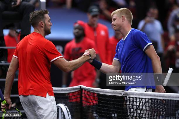 Team World Jack Sock of the United States shakes hands with Team Europe Kyle Edmund of Great Britain after losing his Men's Singles match on day one...