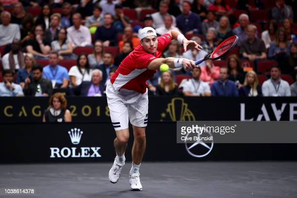 Team World John Isner of the United States returns a shot against Team Europe Roger Federer of Switzerland during their Men's Singles match on day...