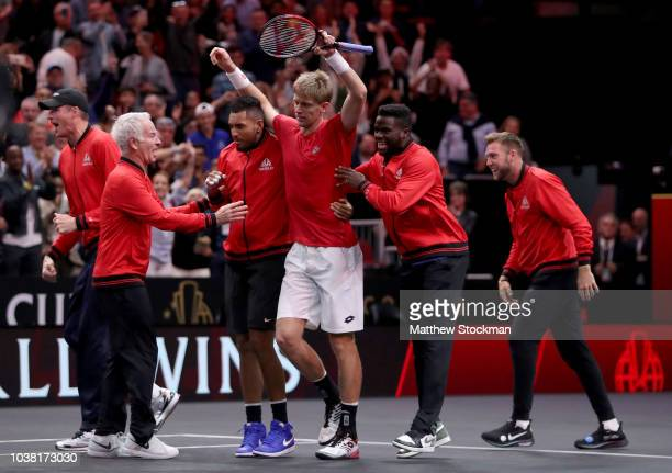 Team World Kevin Anderson of South Africa celebrates with his teammates after defeating Team Europe Novak Djokovic of Serbia in their Men's Singles...