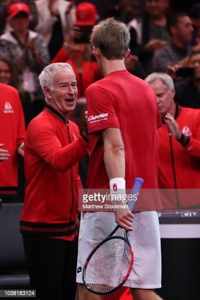 Team World Kevin Anderson of South Africa celebrates with Team World Captain John McEnroe of the United States after defeating Team Europe Novak...