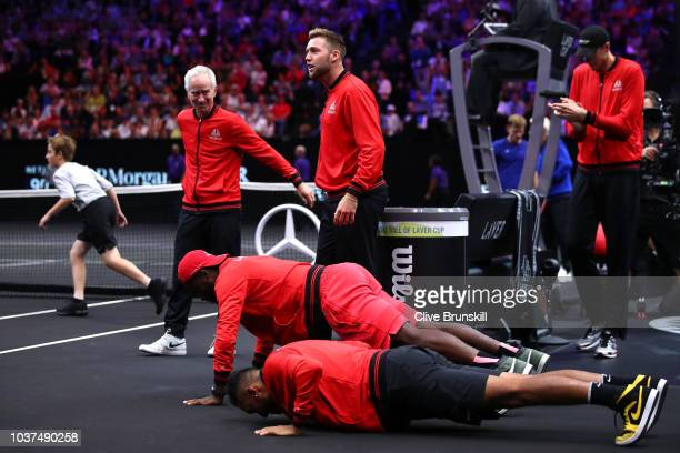 Team World Nick Kyrgios of Australia and Team World Frances Tiafoe of the United States do pushups during the Men's Singles match between Team World...