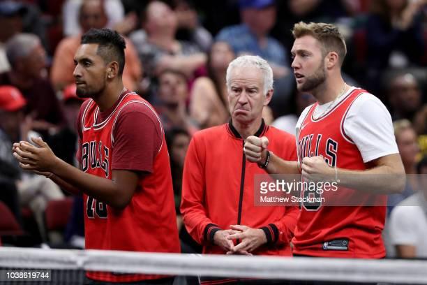 Team World Nick Kyrgios of Australia Team World Captain John McEnroe of the United States and Team World Jack Sock of the United States react during...