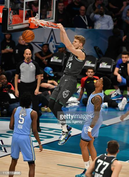 Team World player Lauri Markkanen dunks at the Team USA vs Team World at the NBA Allstar 2019 Rising Stars game at Spectrum Arena in Charlotte NC...