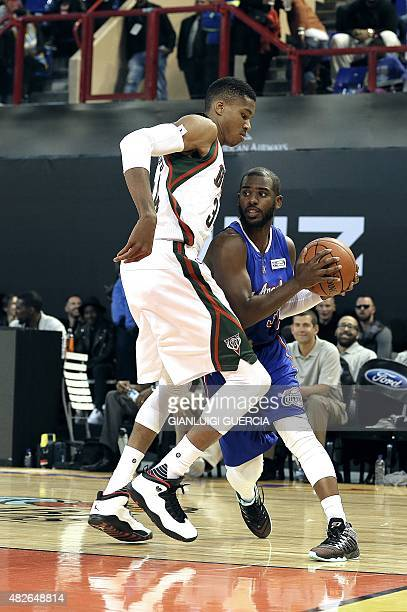 NBA Team World US player Chris Paul of the Los Angeles Clippers tries to pass NBA Team Africa's Greek player Giannis Antetokounmpo of the Milwaukee...
