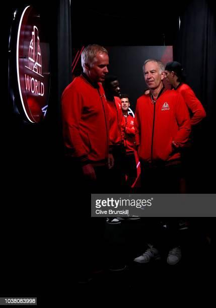 Team World Vice Captain Patrick McEnroe of the United States and Team World Captain John McEnroe of the United States talk prior to the Men's Singles...