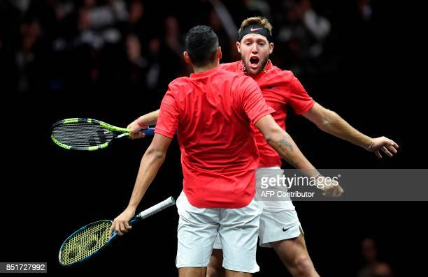 Team World's Jack Sock and Nick Kyrgios react during their match against Team Europa's Rafael Nadal and Tomas Berdych during first day of the Laver...
