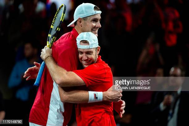 Team World's player Jack Sock and John Isner celebrate after winning their match during the 2019 Laver Cup tennis tournament in Geneva, on September...