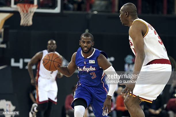 NBA Team World's US captain Chris Paul of the Los Angeles Clippers dribbles and runs with the ball during the NBA Africa basketball match between...