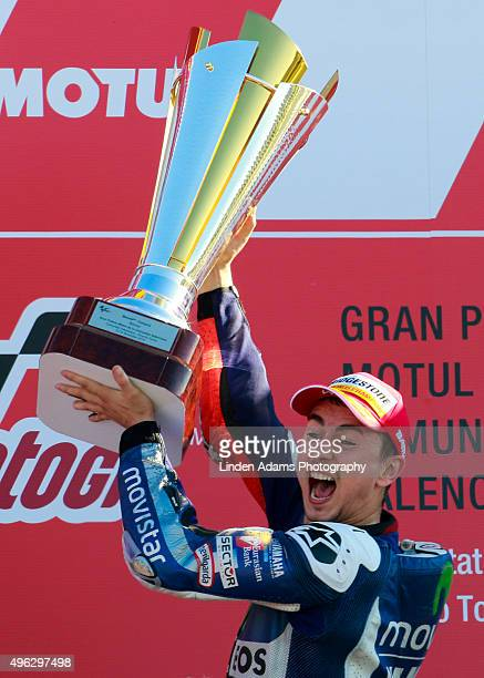 Team Yamaha Movistar's Jorge Lorenzo lifts the victory trophy at Comunitat Valenciana Ricardo Tormo Circuit on November 8 2015 in Valencia Spain...