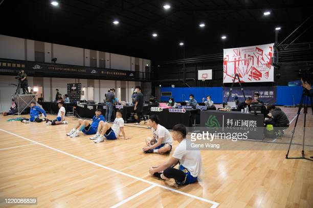 Team Yulon Luxgen Dinos player practice at the courts side prior to the SBL Finals Game One between Taiwan Beer and Yulon Luxgen Dinos at Hao Yu...