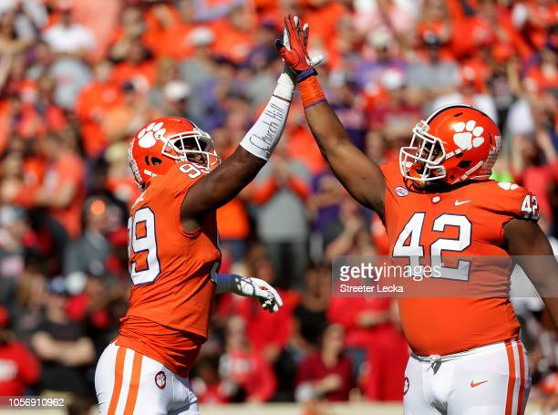 Teamamtes James Edwards and Christian Wilkins of the Clemson Tigers react after a defensive play against the Louisville Cardinals during their game...