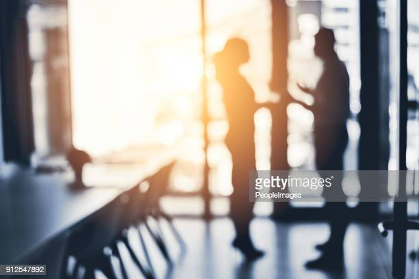 teaming up to push through towards great success - shadow forms stock photos and pictures