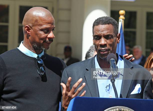 Teammate Darryl Strawberry puts a comradely arm around Dwight Gooden while standing on podium Gooden who has long struggled with alcohol cocaine...