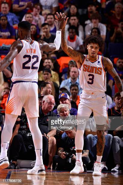 Teammate Deandre Ayton of the Phoenix Suns high fives Kelly Oubre Jr #3 of the Phoenix Suns on October 23 2019 at Talking Stick Resort Arena in...