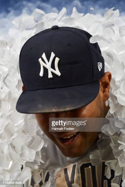 A teammate pours ice on Aaron Hicks of the New York Yankees after the game against the Minnesota Twins on July 23 2019 at Target Field in Minneapolis...