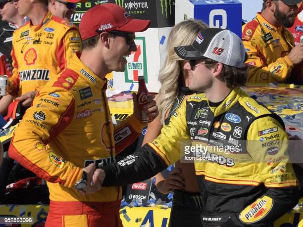 Teammate Ryan Blaney Team Penske Ford Fusion Menards/Richmond congratulates Joey Logano Team Penske Ford Fusion Shell Pennzoil in Victory Lane after...