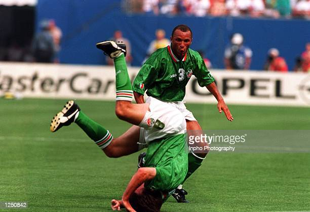 Teammate TERRY PHELAN LOOKS ON DURING IRELAND's 1-0 VICTORY OVER ITALY IN THE 1994 WORLD CUP GAME AT THE MEADOWLANDS+ GIANTS STADIUM IN EAST...