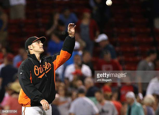 Teammate throws Tyler Wilson of the Baltimore Orioles the game ball after defeating Boston Red Sox at Fenway Park on June 16, 2016 in Boston,...