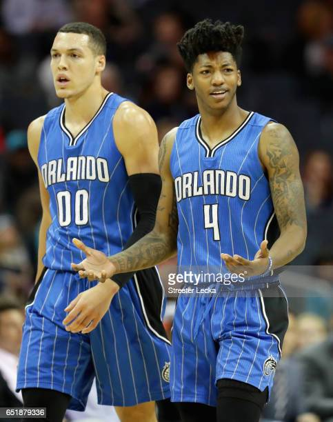 Teammates Aaron Gordon and Elfrid Payton of the Orlando Magic react after a call during their game against the Charlotte Hornets at Spectrum Center...