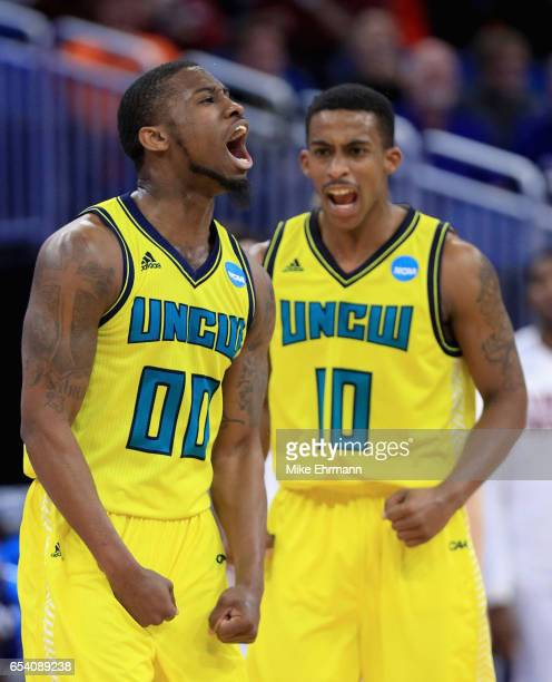 Teammates Ambrose Mosley and Denzel Ingram of the North CarolinaWilmington Seahawks react after a play against the Virginia Cavaliers during the...