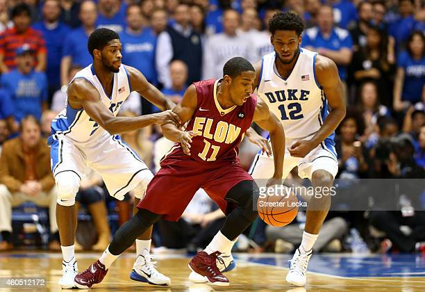Teammates Amile Jefferson and Justise Winslow of the Duke Blue Devils try to steal the ball from Kevin Blake of the Elon Phoenix during their game at...