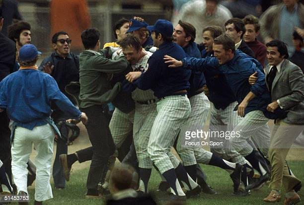 Teammates and fans alike mob starter and winner pitcher Jerry Koosman of the New York Mets after the Mets win Game Five of the World Series against...