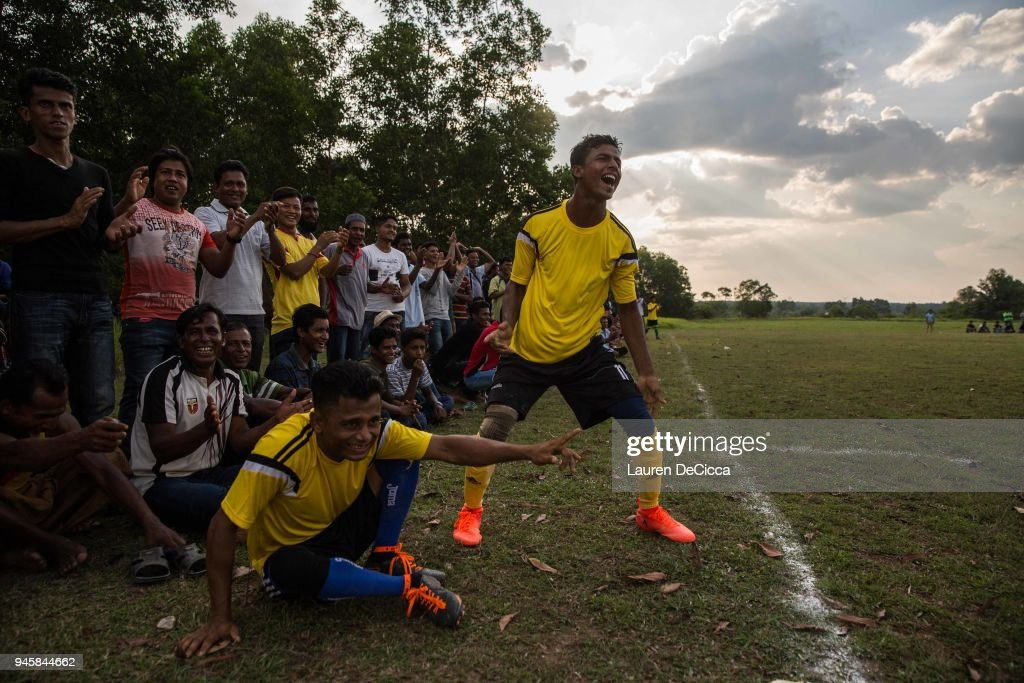 Teammates and fans cheer as the Kedah Kulim Rohingya Football Club plays the Kedah Kulim junior team in a weekly match on April 13, 2018 in Kulim, Malaysia. A group of Rohingya refugees from Myanmar's Rakhine State formed the Rohingya Football Club in Malaysia back in 2015, hoping to give the Rohingya people a voice through sports and raise their international profile amidst the crisis in the region. Rohingya Muslims are reportedly playing in Football Clubs around the world, including Canada, Australia, and Ireland, while the Rohingya F.C. aims to set up a national team which comprises of these players and show that Rakhine Muslims can succeed in the sport. The United Nations estimate that over 62 thousand Rohingya are currently living in Malaysia and most of them are only able to find jobs as a construction worker or laborer with many staying in makeshift homes near construction sites. Malaysia launched its first Rohingya tournament this year with 24 independent football clubs competing across the Muslim country, hoping to gather support from the Malaysian and Turkish governments to help them succeed at an international level. Over 700,000 Muslim Rohingya have crossed the border into Bangladesh since August last year after the Myanmar military launched a brutal crackdown which was described by the United Nations as 'ethnic cleansing' while the two countries continue to negotiate the repatriation of the Rohingya refugees.