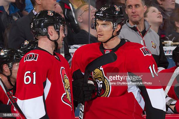 Teammates Andre Benoit and Mike Lundin of the Ottawa Senators talk during an NHL game against the Boston Bruins at Scotiabank Place on March 21 2013...