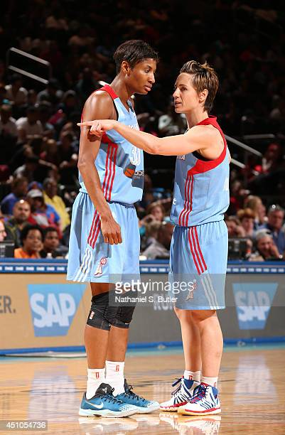 Teammates Angel McCoughtry and Celine Dumerc of the Atlanta Dream during a game against the New York Liberty at Madison Square Garden in New York...