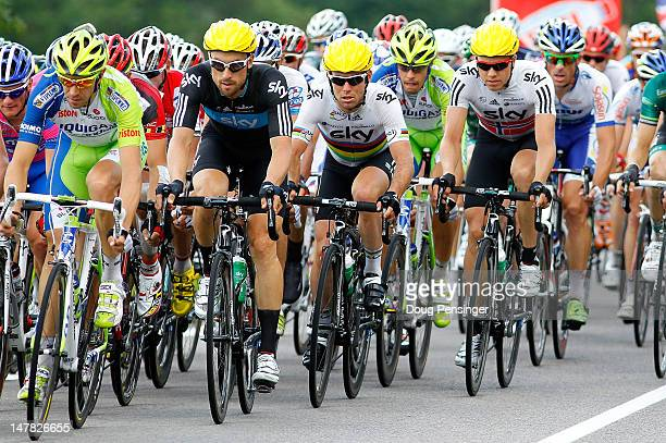 Teammates Bernhard Eisel of Austria Mark Cavendish of Great Britain and Edvold Boasson Hagen of Norway riding for Sky Procycling ride in the peloton...
