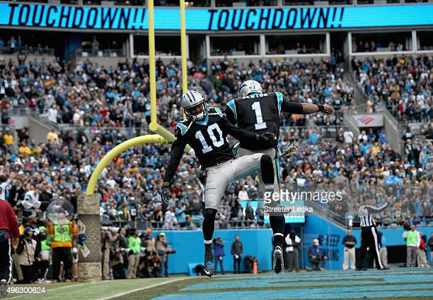 Teammates Cam Newton and Corey Brown of the Carolina Panthers celebrate after a touchdown during their game against the Green Bay Packers at Bank of...