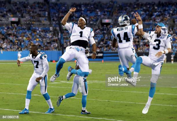 Teammates Cam Newton Joe Webb and Derek Anderson of the Carolina Panthers react after a play during their game against the Pittsburgh Steelers at...