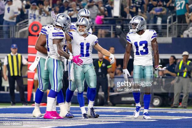 Teammates celebrate after Dallas Cowboys wide receiver Cole Beasley scores a touchdown during the game between the Jacksonville Jaguars and Dallas...