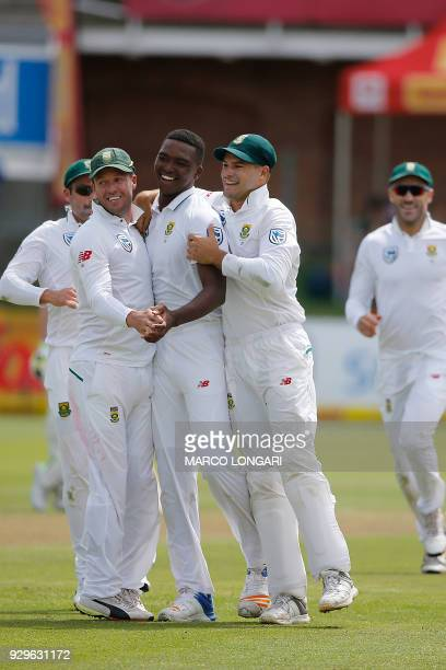 Teammates celebrate South Africa bowler Lungi Ngidi taking the wicket of Australia batsman David Warnerduring day one of the second Sunfoil Test...