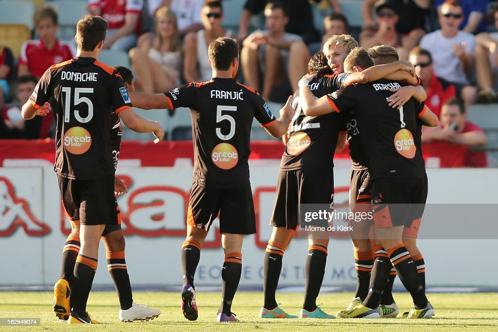 Teammates celebrate with Ben Halloran of Brisbane after he scored a goal during the round 23 A-League match between Adelaide United and the Brisbane Roar at Hindmarsh Stadium on March 2, 2013 in Adelaide, Australia.