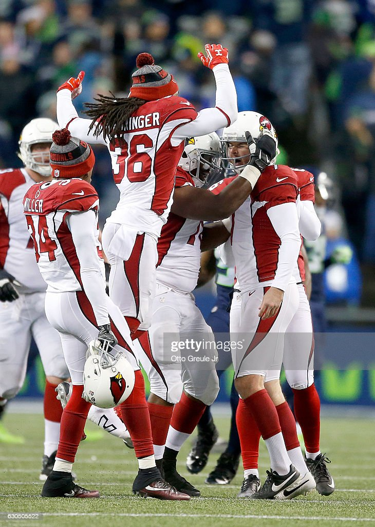 Teammates celebrate with kicker Chandler Catanzaro #7 of the Arizona Cardinals after he kicked the game-winning field goal against the Seattle Seahawks at CenturyLink Field on December 24, 2016 in Seattle, Washington.