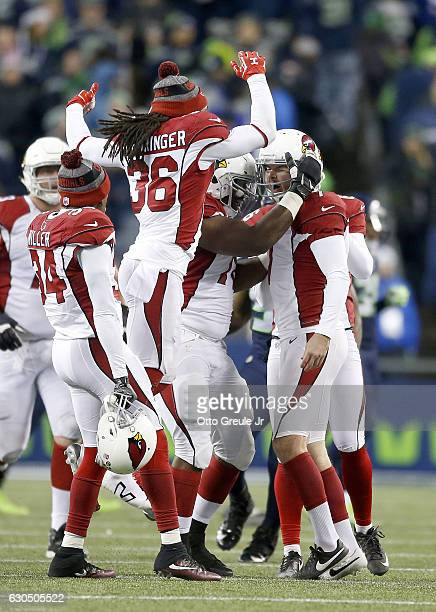 Teammates celebrate with kicker Chandler Catanzaro of the Arizona Cardinals after he kicked the gamewinning field goal against the Seattle Seahawks...